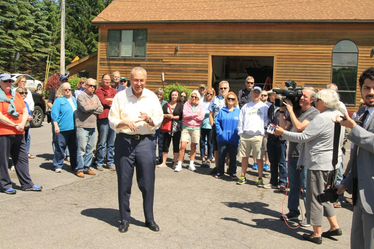 Schumer visits lake as anger, waves crest