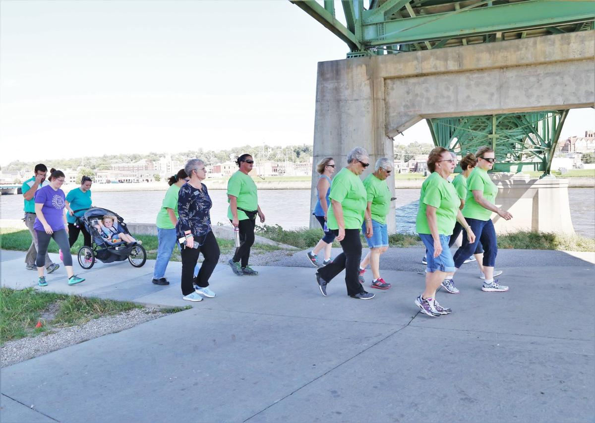 Ottumwa residents take a walk by the river.