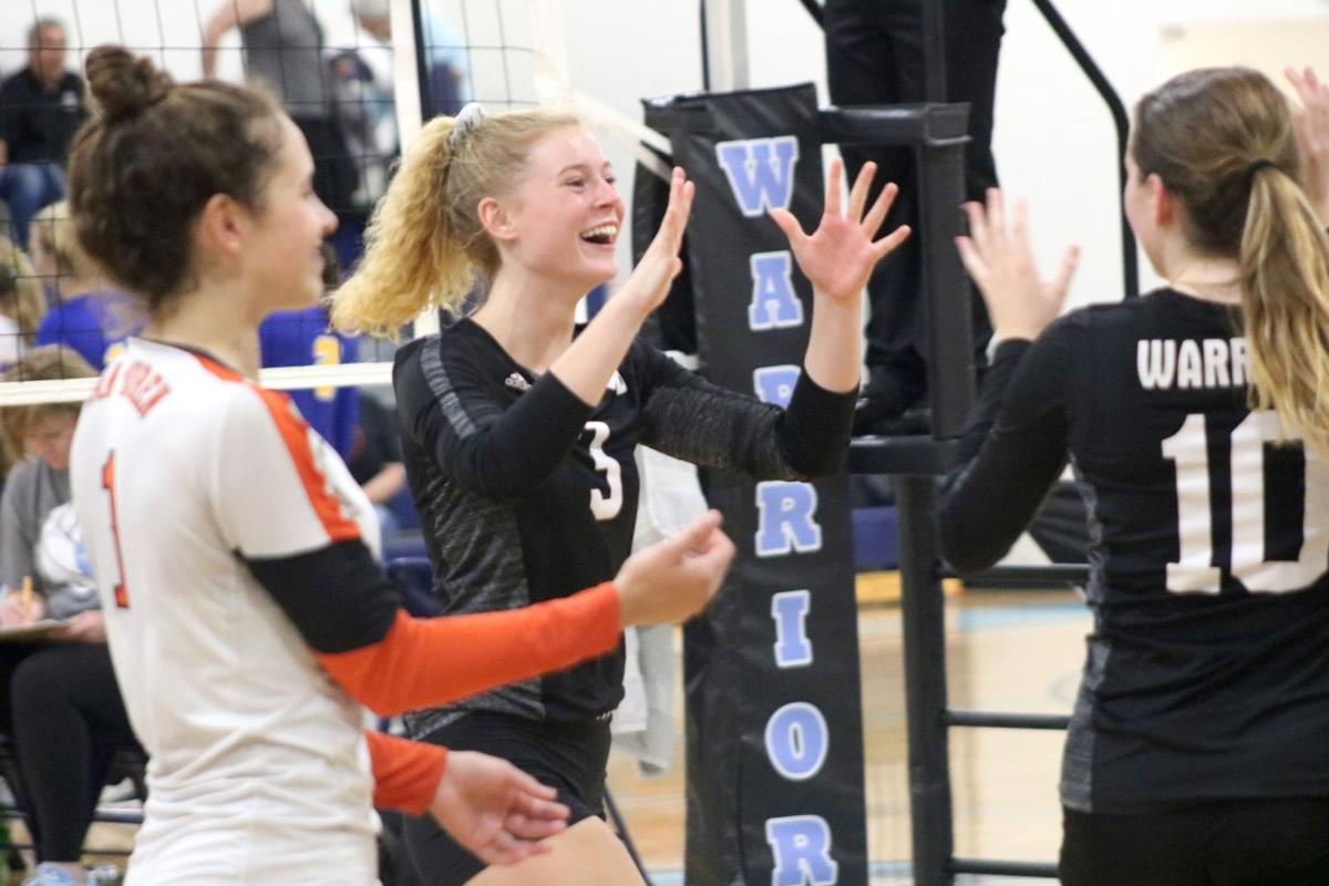 Prep volleyball: No. 5 Warriors battle back for WACO title