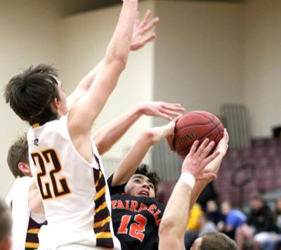Boys basketball: Free throw with second left trips Trojans