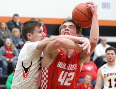 Boys basketball: Unselfish play guides Bulldogs past Demons