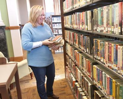 Sonja Ferrell putting away large-print books