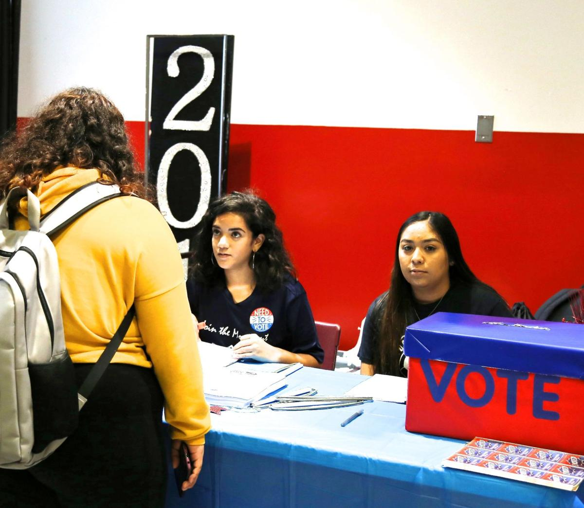 High school voters check in with Evelyz Rivera and Inez Sanchez