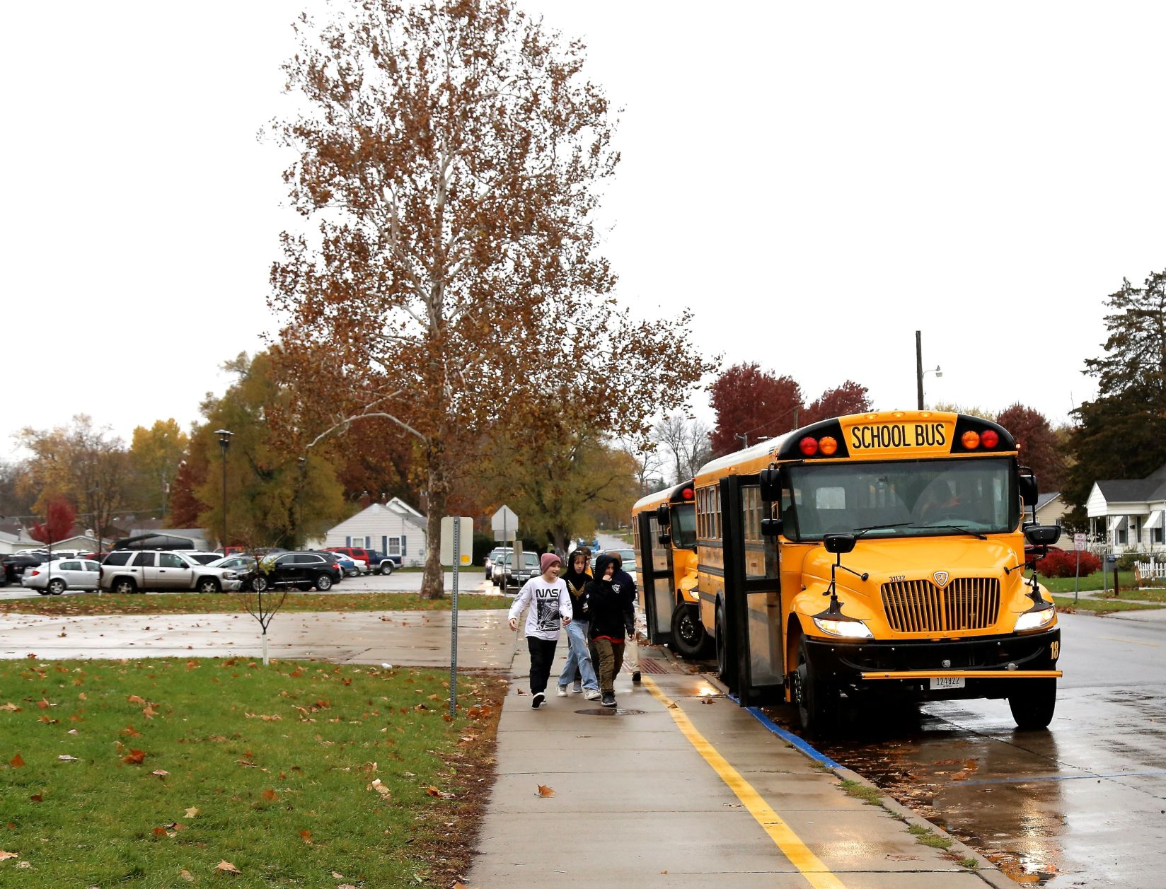 Ottumwa students board buses after school in courier file photo.