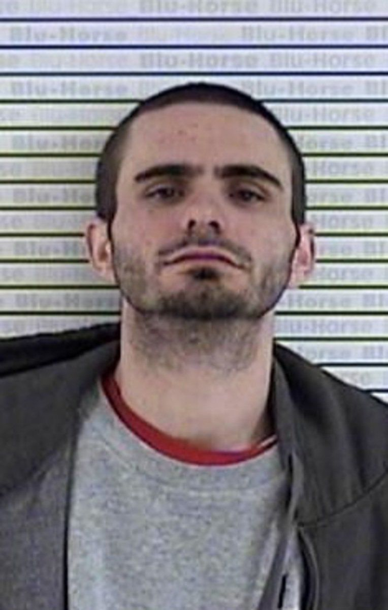 Man arrested in stolen, forged check case