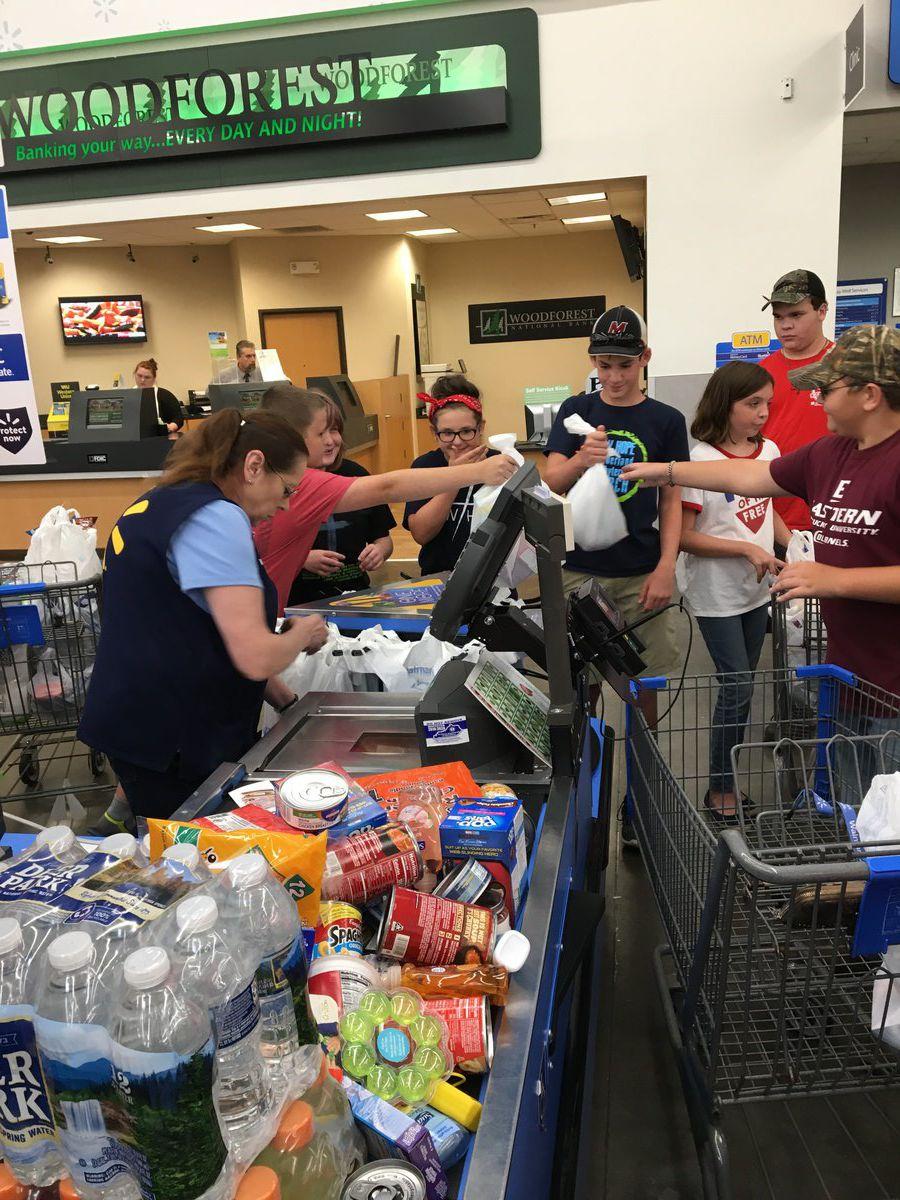 Youth group stocks food pantries