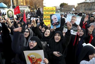 Defying police, Iranians protest plane shootdown