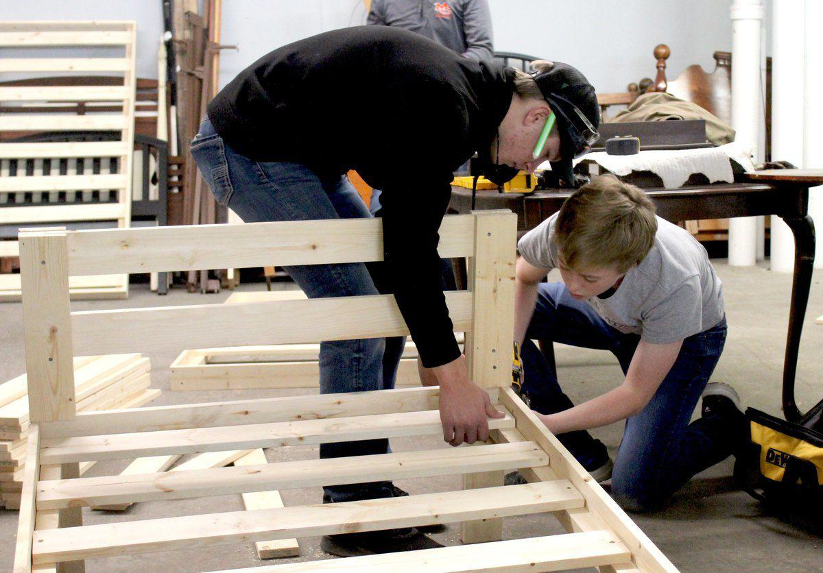 Area carpentry students build beds for local families in need
