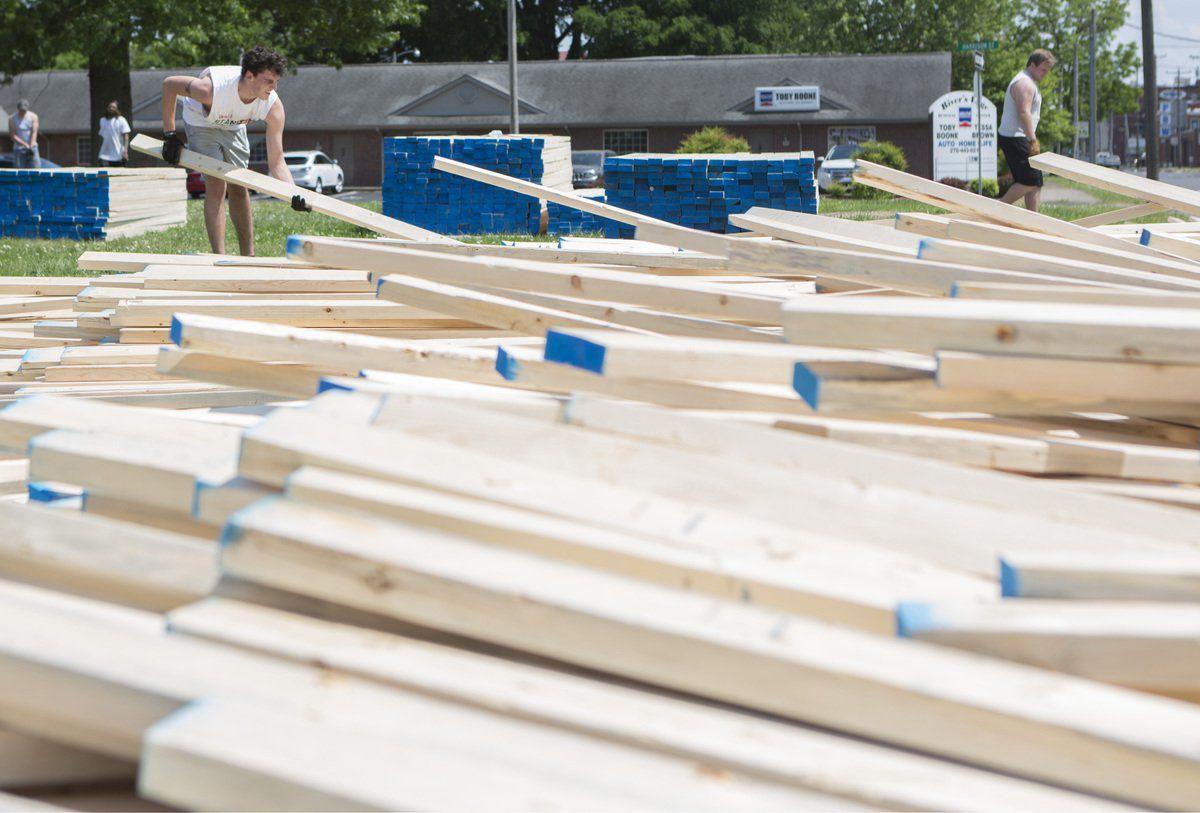 Truck tips over, spills lumber