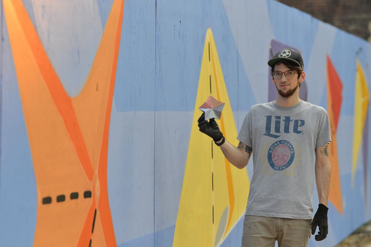 Local artist completes vibrant, new downtown mural