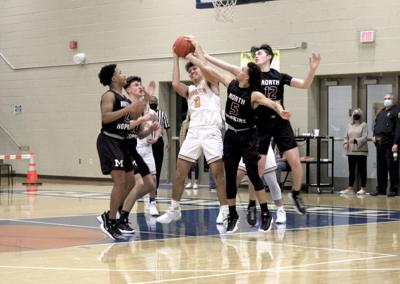 Marrons win district opener at Caldwell 62-56