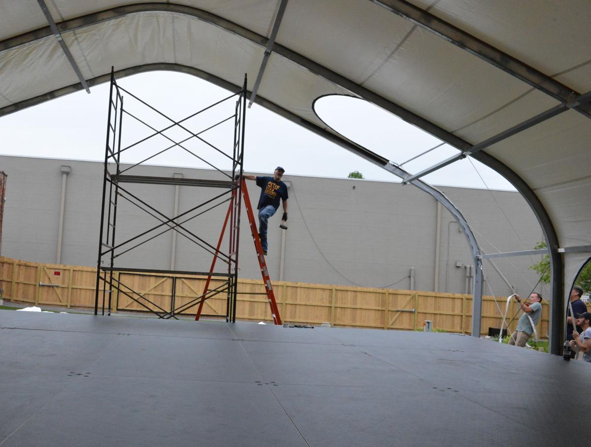 Market House has got it covered: Theatre installs stage, canopy in courtyard for outdoor programming