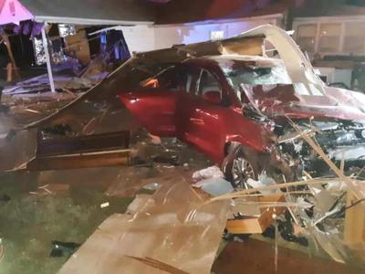 Sleeping Kevil couple, driver injured after car hits house