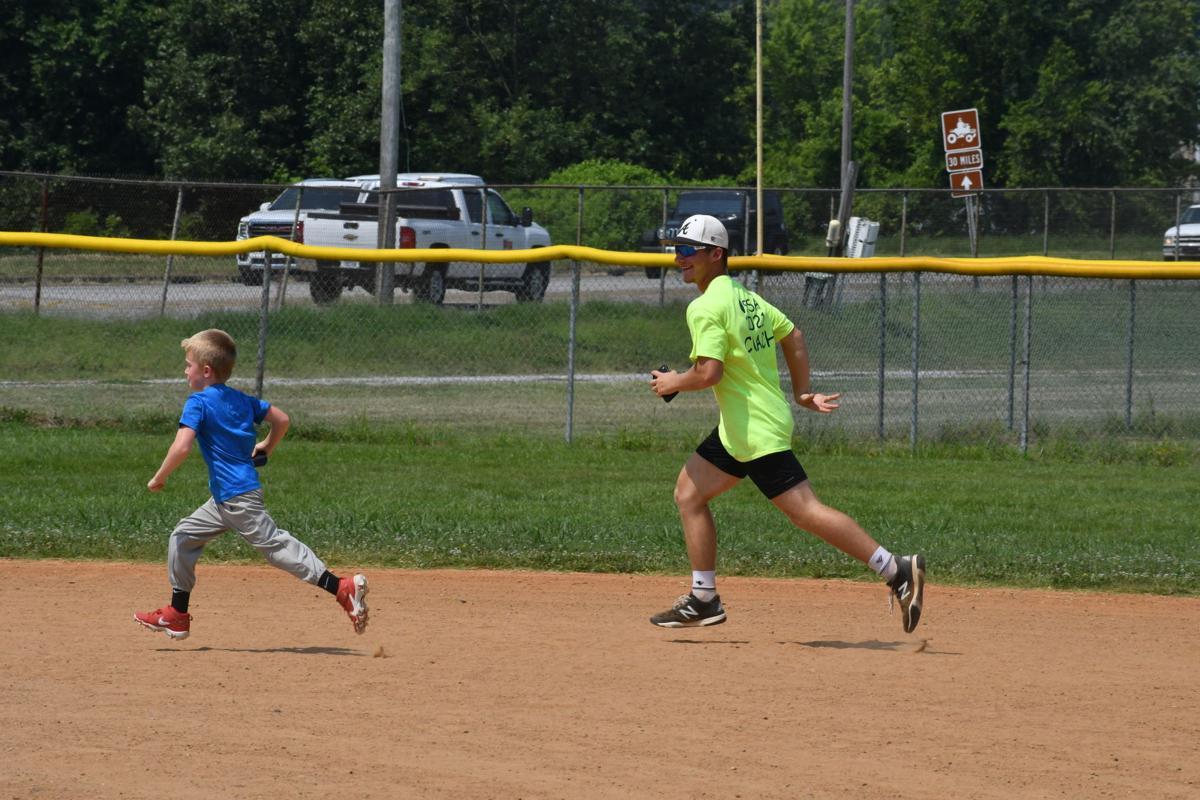 Kendal Kortz runs bases with camper