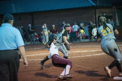 Abby Fannin tosses the ball over to Alaina Castle