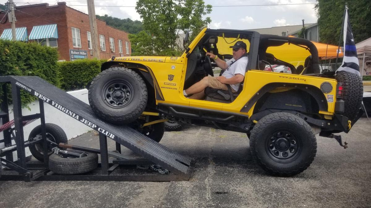 Jeeps line the streets of downtown Paintsville for National Jeep Day event