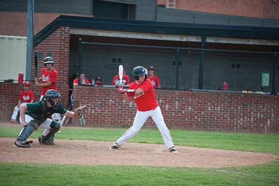 The Reds Jon Little snags a double in Babe Ruth 15U league action against the Athletics on Monday.jpg