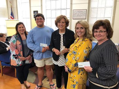 PHS Alumni donate $10K to schools