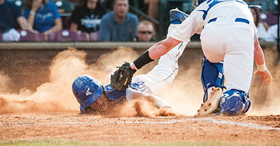 Ryan Gibson attempts to slide into home