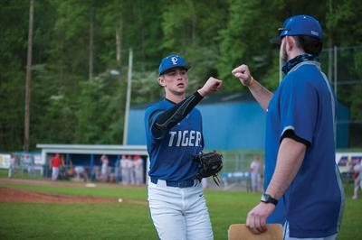 5-5 paint Greyson Peters Celebrates a strikeout to close an inning with a coach vs Belfry.jpg