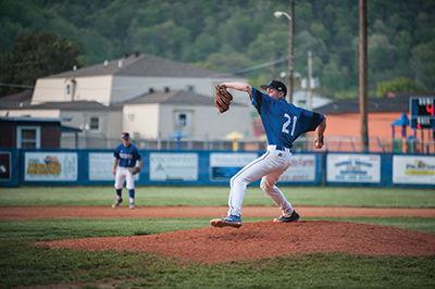 Paintsville's Matt Combs winds up for a pitch