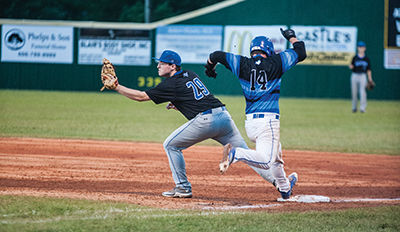 Jonathan McKenzie attempts to make it to first base