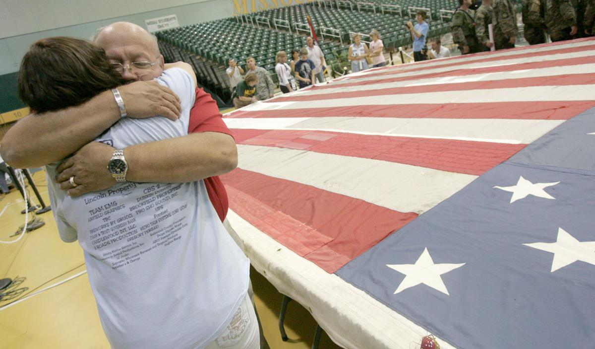 Tornado survivors reflect on 9/11 flag as it finds permanent display