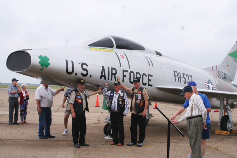F-100A with people around