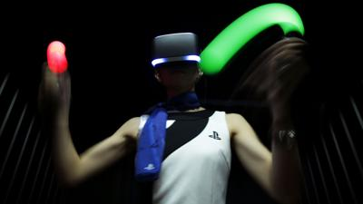HTC takes on Sony with headset that allows users to roam virtual worlds