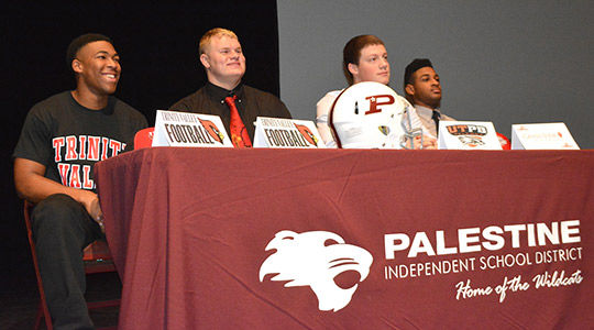 SIGN 'EM UP! Four Palestine football players ink letters of intent