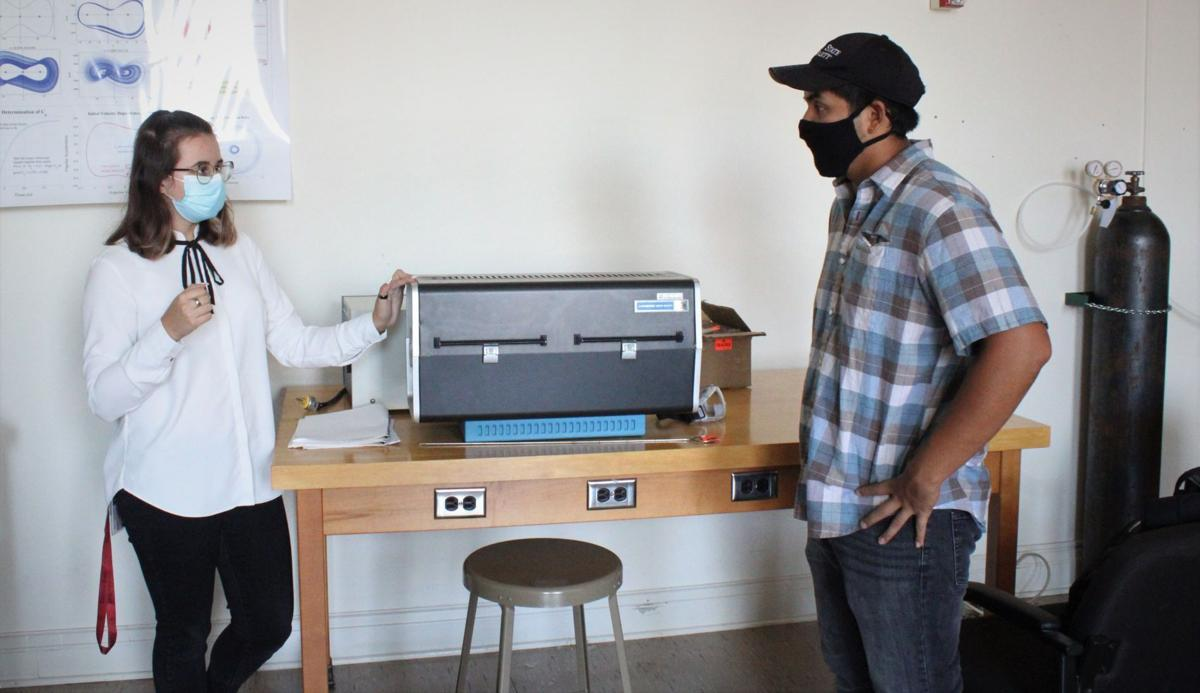 Students discuss nanoparticle furnace