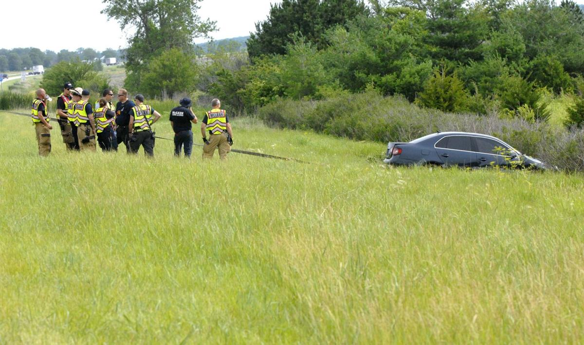 Photos: Firefighters recover car and driver after McLean I-55