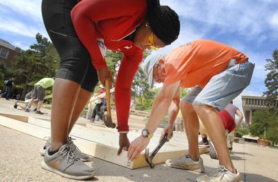 ISU students pound nails, begin work on Habitat house