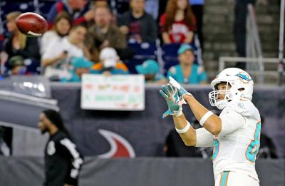Miami Dolphins tight end Mike Gesicki warms up before action against the Houston Texans at NRG Stadium in Houston on October 25, 2018.