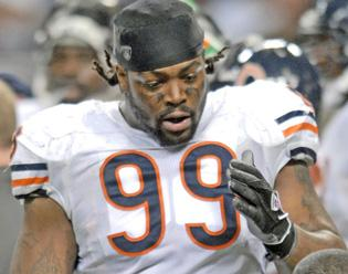 NFL suspends Bears' Tank Johnson for 8 games