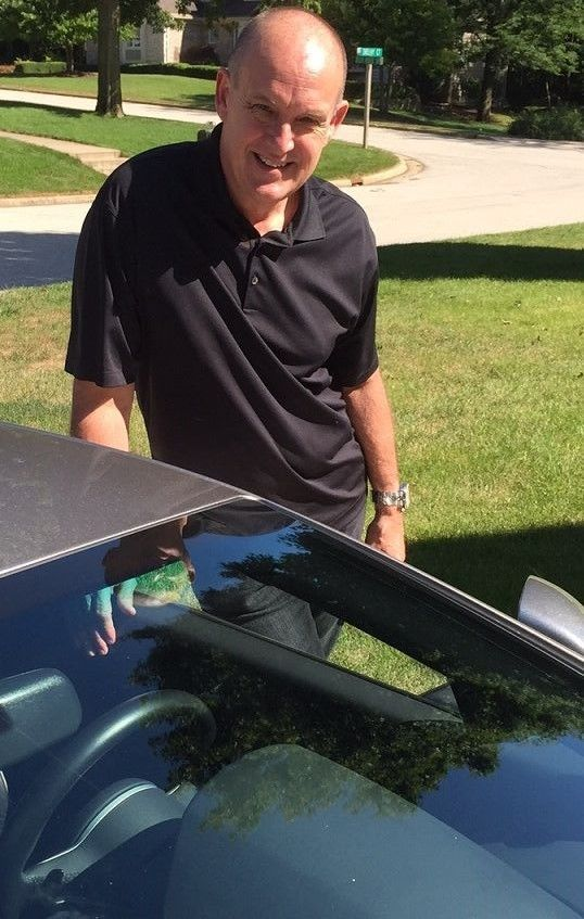 Dave Magers, next to his Lamborghini