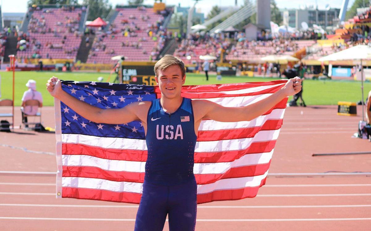 Zachery Bradford with flag at U20 World Championships