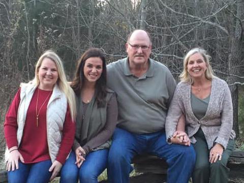 Denver Johnson family in woods