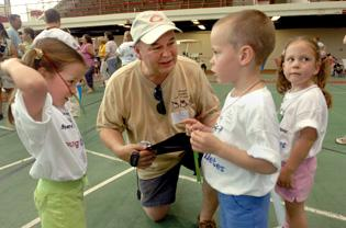 Dads see kids 'come a long way' at Special Olympics