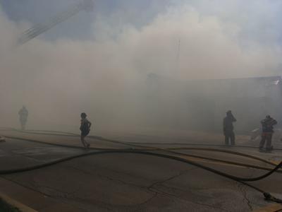 'Oh, my God': Pontiac furniture store, ambulance building burn