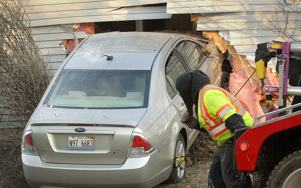 Car crashes into Normal home