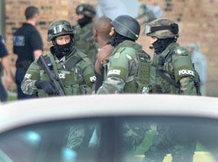 Police surround Arbors building, arrest man