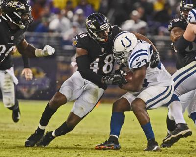 The Baltimore Ravens' Patrick Onwuasor (48) tackles Indianapolis Colts running back Frank Gore at M & T Bank Stadium in Baltimore on December 23, 2017.
