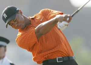 Tiger takes control; Els rises to challenge
