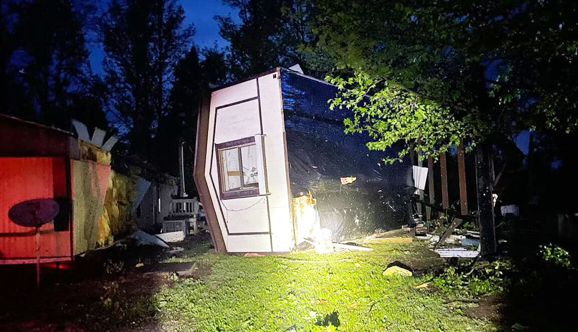 Storms flip home on lake highway