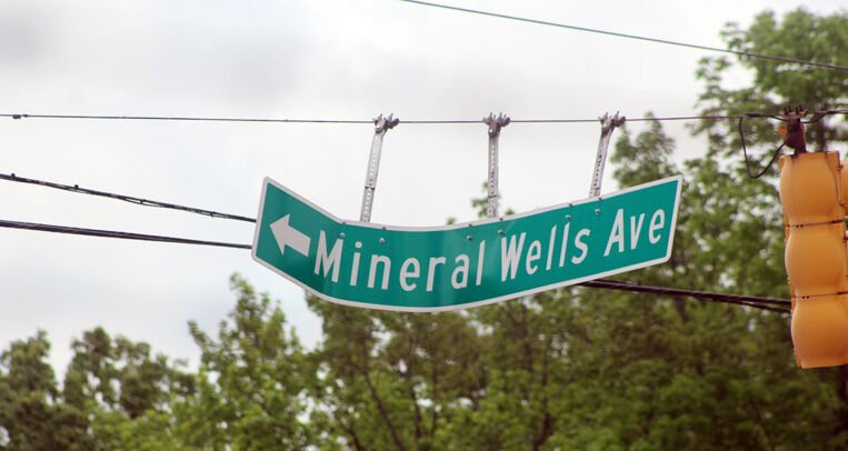 Mineral Wells Avenue sign warped by winds