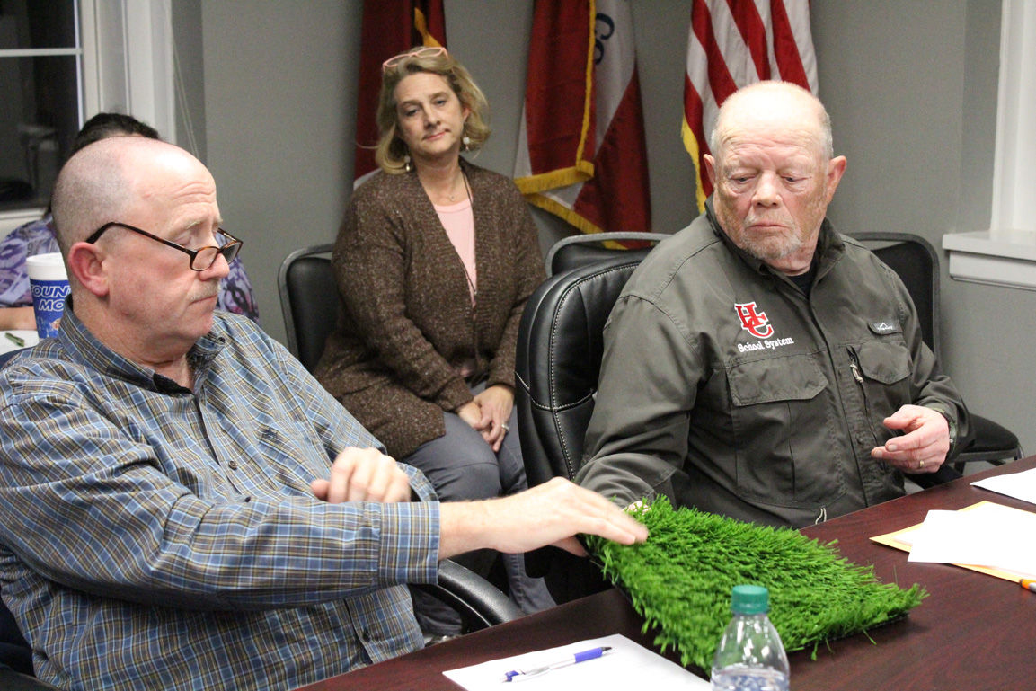 Board considers artificial turf