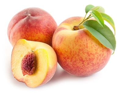 Ripe peach fruit with leaves and slises