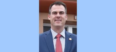 "Stitt signs controversial ""anti-red flag"" gun measure"