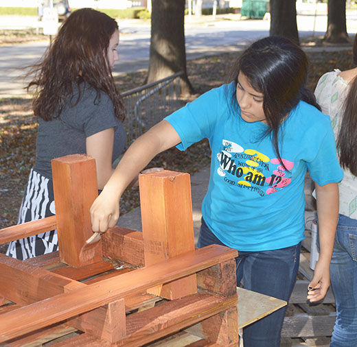 Classroom Furniture Grant ~ Students making art out of school park news